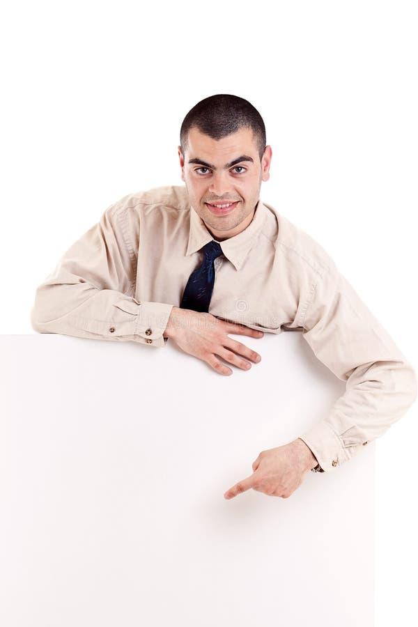Hombre de negocios que muestra el letrero en blanco imagen de archivo