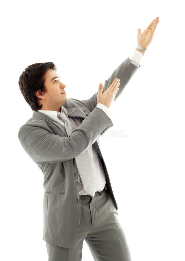 Hombre de negocios que muestra el producto imaginario #2 imagenes de archivo