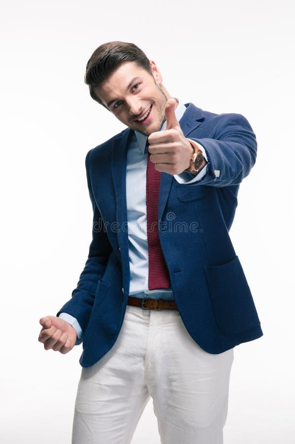 Hombre de negocios que muestra el pulgar encima de la muestra fotografía de archivo libre de regalías