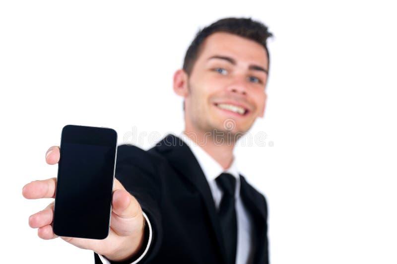 Hombre de negocios que muestra el teléfono fotos de archivo