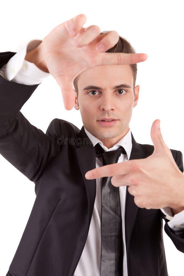 Hombre de negocios que muestra gesto de mano que enmarca foto de archivo