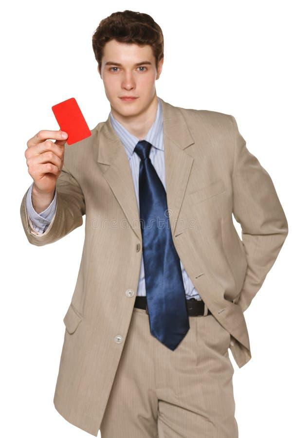 Hombre de negocios que muestra la tarjeta del crédito en blanco fotos de archivo
