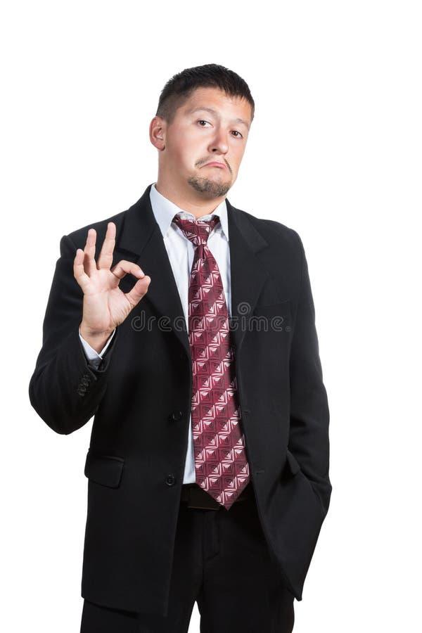 Hombre de negocios que muestra muy bien fotos de archivo