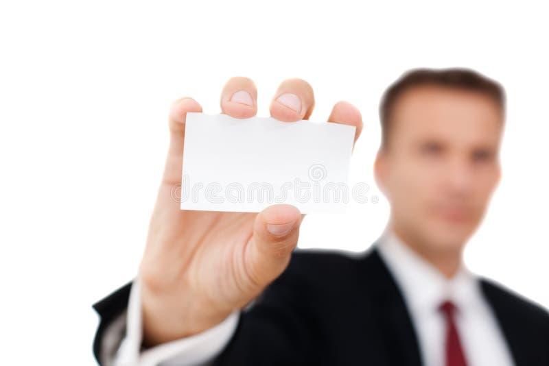 Hombre de negocios que muestra su tarjeta de visita imagen de archivo