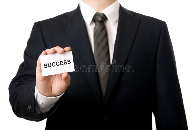 Hombre de negocios que muestra una tarjeta imagen de archivo libre de regalías