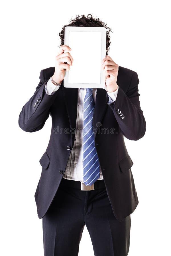 Hombre de negocios que oculta su cara con una tableta foto de archivo libre de regalías