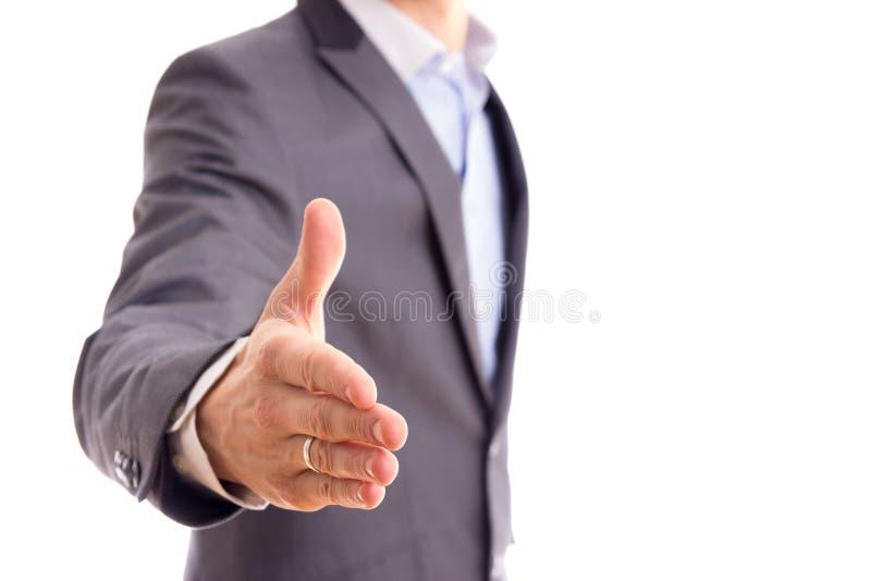 Hombre de negocios que ofrece para el apretón de manos foto de archivo libre de regalías