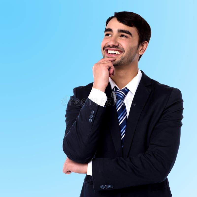Hombre de negocios que piensa algo fotografía de archivo libre de regalías