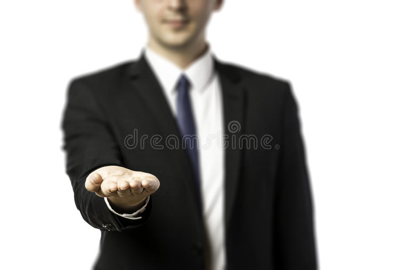 Hombre de negocios que presenta algo foto de archivo