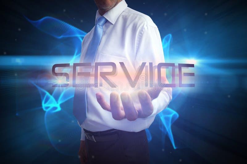 Hombre de negocios que presenta el servicio de la palabra imagen de archivo libre de regalías