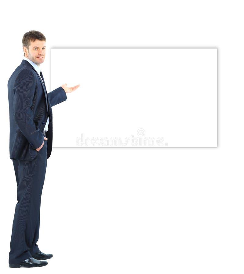 Hombre de negocios que presenta y que muestra con el espacio de la copia para su texto imagen de archivo libre de regalías