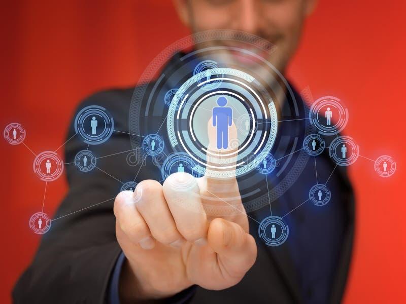 Hombre de negocios que presiona el botón con el contacto foto de archivo libre de regalías