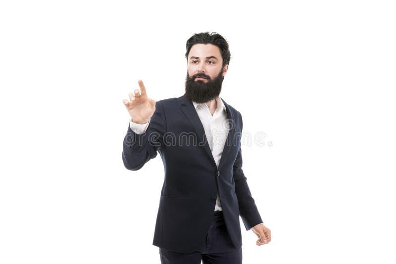 Hombre de negocios que presiona un botón imaginario fotos de archivo