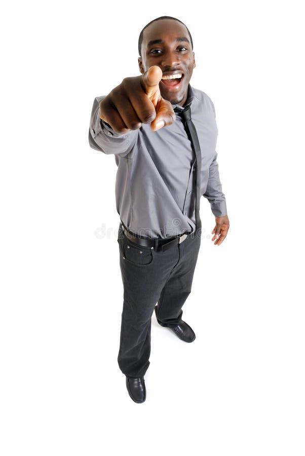 Hombre de negocios que ríe y que señala fotos de archivo