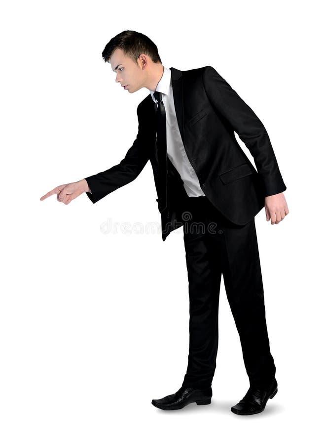 Hombre de negocios que señala abajo fotografía de archivo