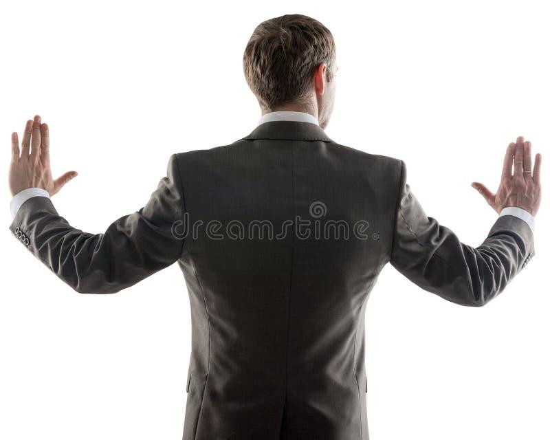 Hombre de negocios que señala en el espacio de la copia imagen de archivo libre de regalías