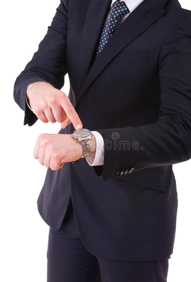 Hombre de negocios que señala en su reloj. fotos de archivo