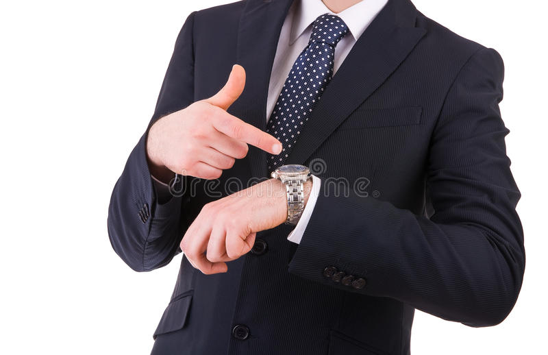 Hombre de negocios que señala en su reloj. fotografía de archivo libre de regalías