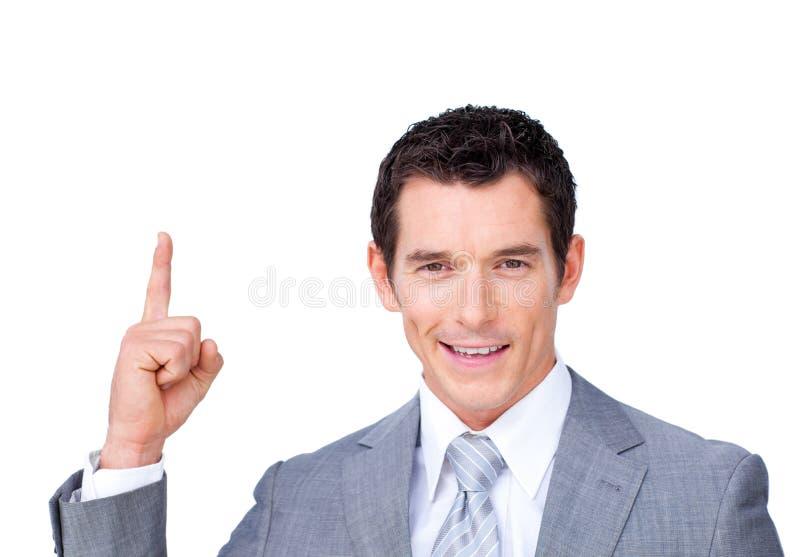 Hombre de negocios que señala la tapa imagen de archivo