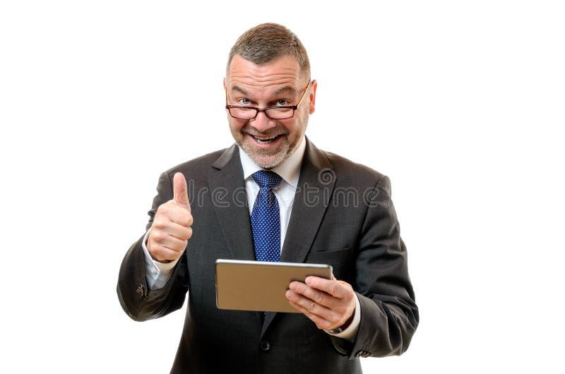 Hombre de negocios que señala su éxito y aprobación fotografía de archivo