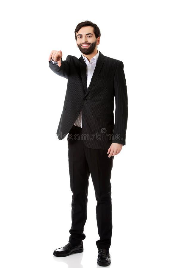 Hombre de negocios que señala su finger en usted imágenes de archivo libres de regalías