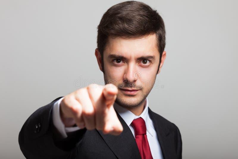 Hombre de negocios que señala su finger a usted imagen de archivo