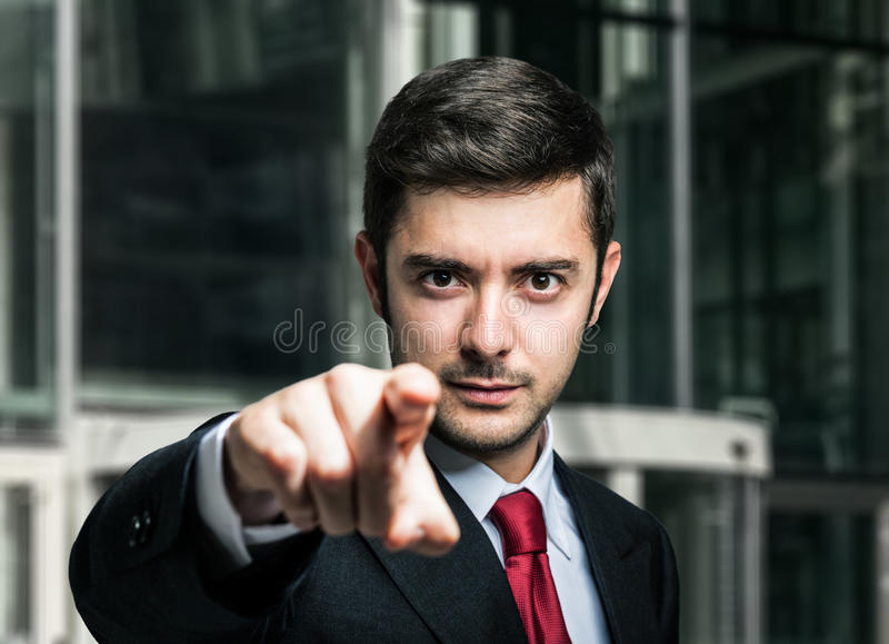 Hombre de negocios que señala su finger a usted foto de archivo libre de regalías