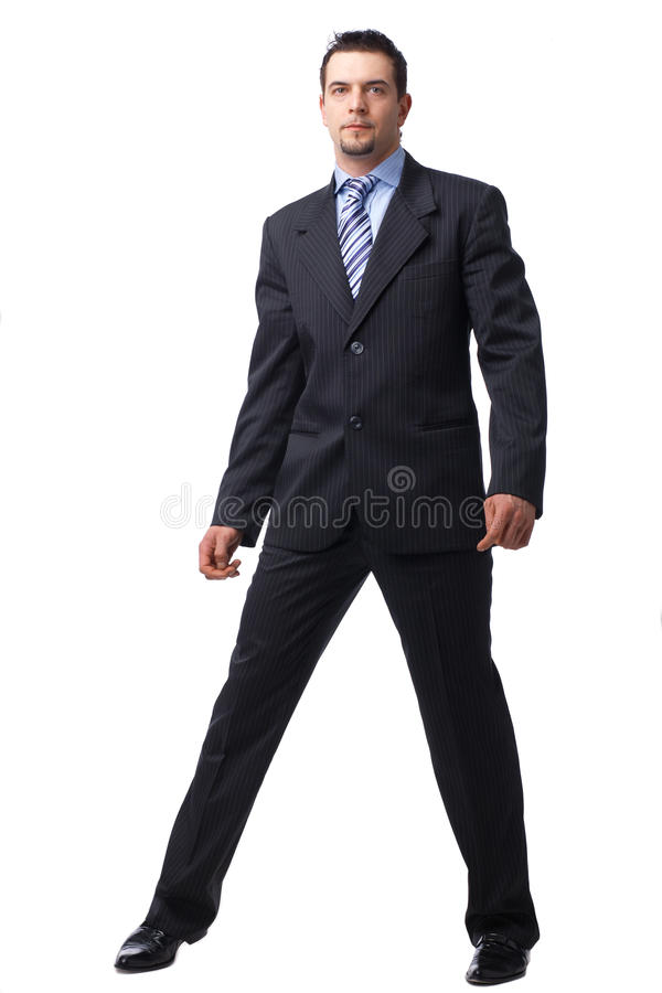 Hombre de negocios que se coloca sobre blanco. foto de archivo libre de regalías