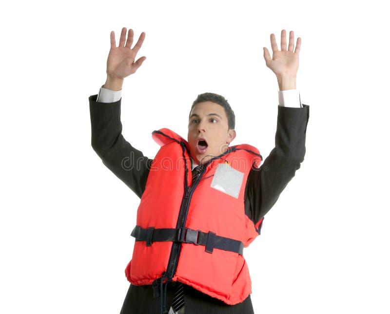 Hombre de negocios que se hunde en la crisis, metáfora del chaleco salvavidas imagenes de archivo
