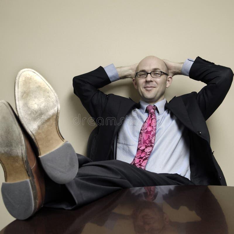 Hombre de negocios que se relaja fotografía de archivo