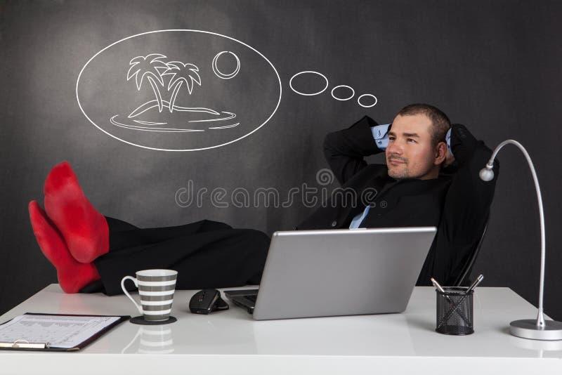 Hombre de negocios que se relaja y que sueña fotos de archivo