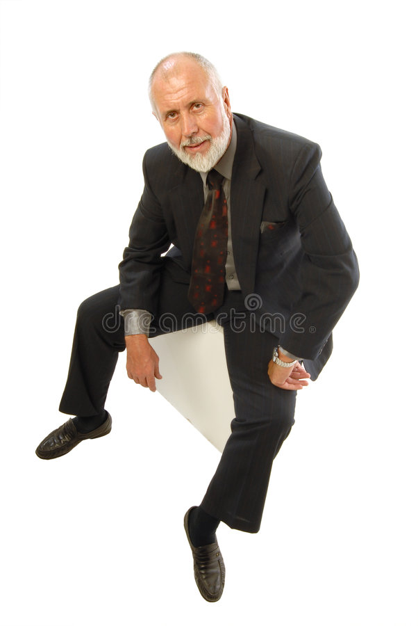 Hombre de negocios que se sienta fotos de archivo libres de regalías