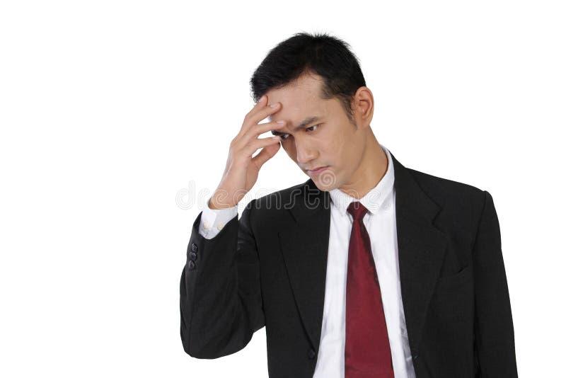 Hombre de negocios que siente mal, aislado en blanco fotos de archivo