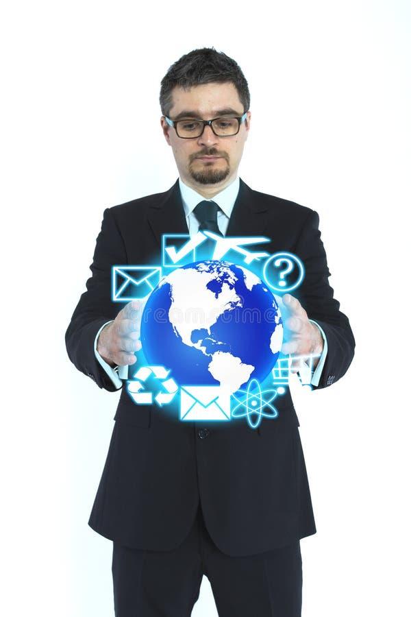 Hombre de negocios que sostiene el globo fotografía de archivo libre de regalías