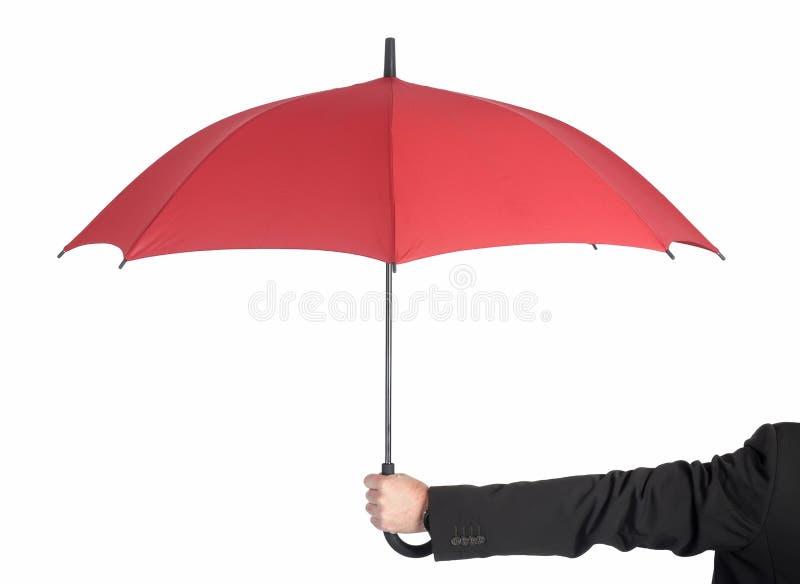 Hombre de negocios que sostiene el paraguas foto de archivo libre de regalías