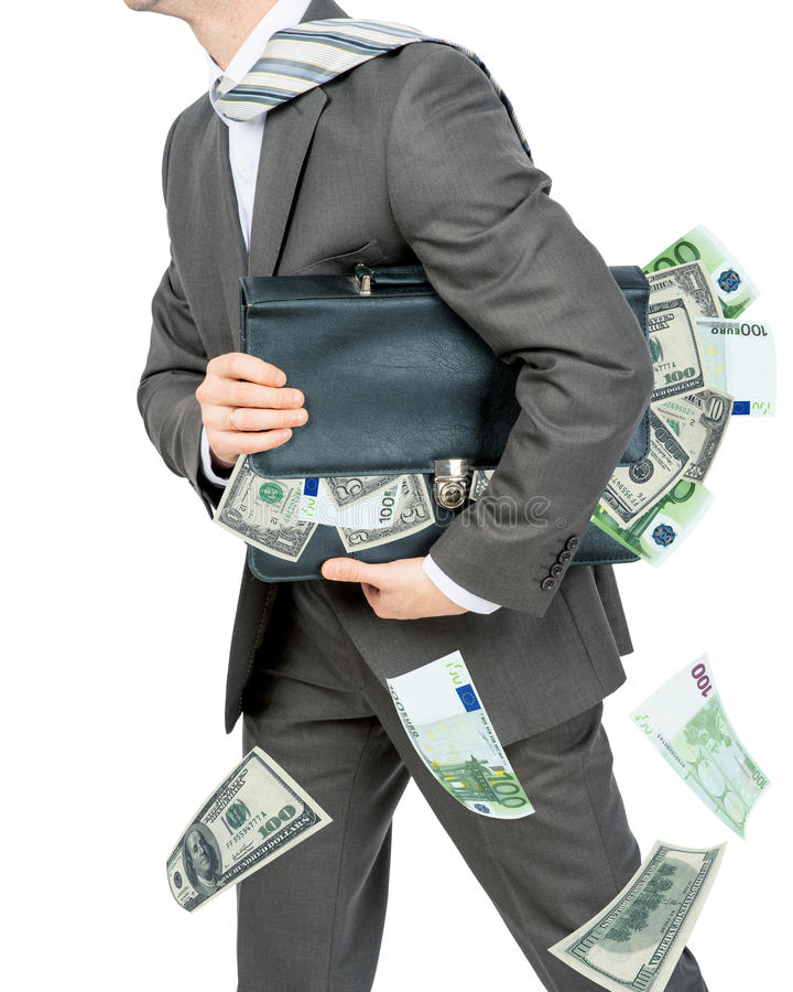 Hombre de negocios que sostiene la cartera llena de dinero imagenes de archivo