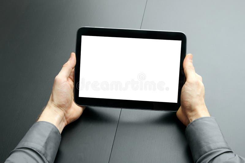 Hombre de negocios que sostiene la tableta digital en blanco foto de archivo libre de regalías