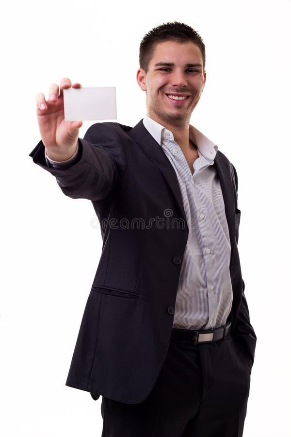 Hombre de negocios que sostiene una tarjeta de visita vacía fotografía de archivo