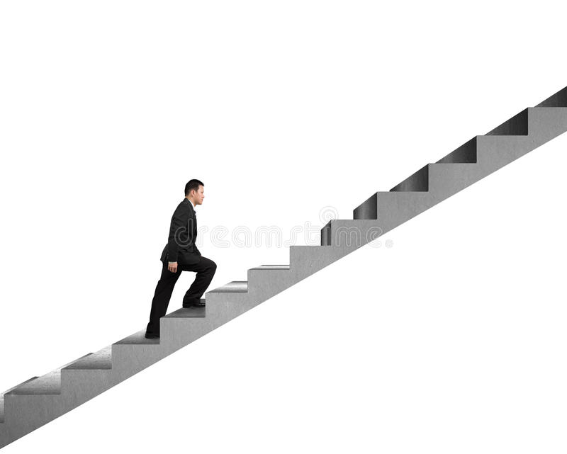 Hombre de negocios que sube en la escalera concreta aislada en blanco fotografía de archivo libre de regalías