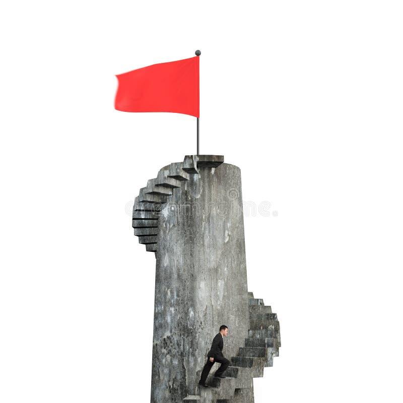 Hombre de negocios que sube la escalera espiral hacia bandera roja en torre imágenes de archivo libres de regalías
