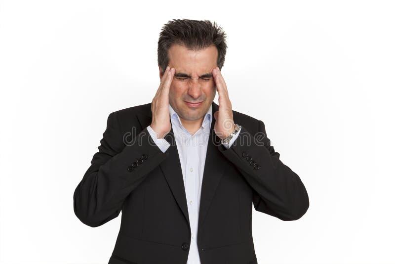 Hombre de negocios que tiene dolor de cabeza imagen de archivo