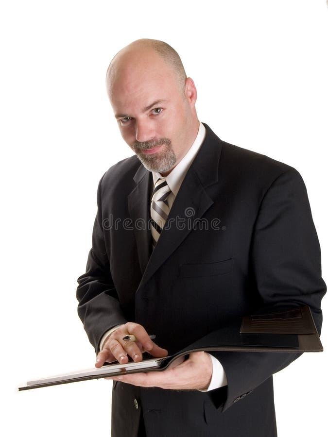 Hombre de negocios que toma notas fotografía de archivo libre de regalías