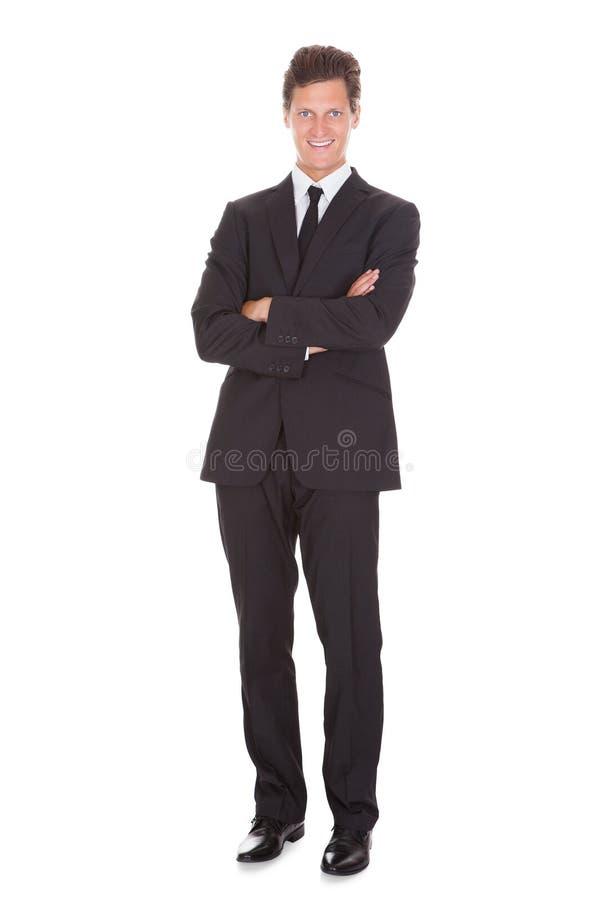 Hombre de negocios que trabaja en el escritorio fotos de archivo