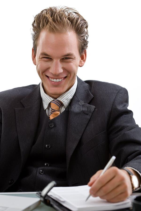 Hombre de negocios que trabaja en la computadora portátil aislada fotos de archivo libres de regalías