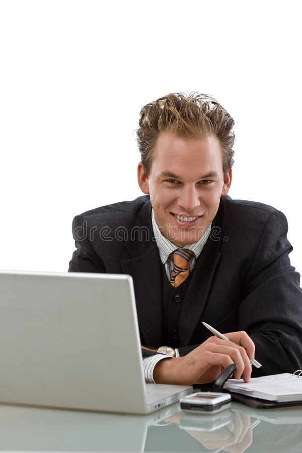 Hombre de negocios que trabaja en la computadora portátil aislada imágenes de archivo libres de regalías