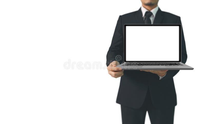 Hombre de negocios que usa el ordenador portátil digital a disposición imagenes de archivo