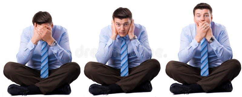 Hombre de negocios sabio tres que no oyeron, hablar y ver. foto de archivo libre de regalías