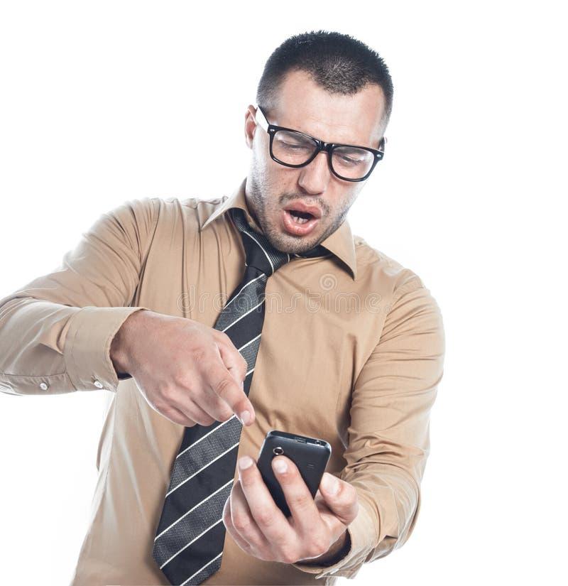 Hombre de negocios salido en el teléfono imagenes de archivo