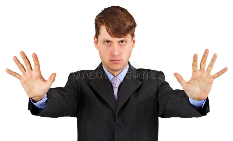 Hombre de negocios serio con la detención del gesto aislado en blanco fotografía de archivo
