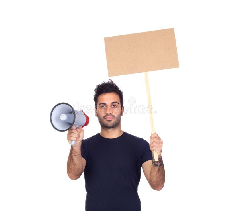 Hombre de negocios serio con un megáfono y una bandera imagenes de archivo